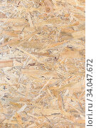 Купить «OSB panel texture. Oriented Strand Board. Chipboard building material. OSB wooden panel made of pressed sandy brown wood shavings as background», фото № 34047672, снято 25 марта 2020 г. (c) Nataliia Zhekova / Фотобанк Лори