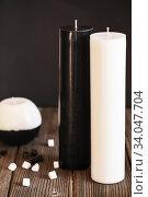 Купить «Decorative Handmade sphere and cylinder shape candles. Big black and white gift candles», фото № 34047704, снято 16 января 2020 г. (c) Nataliia Zhekova / Фотобанк Лори