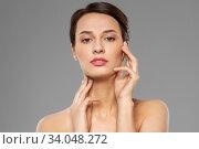 Купить «beautiful young woman touching her face», фото № 34048272, снято 30 ноября 2019 г. (c) Syda Productions / Фотобанк Лори
