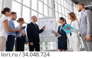 Купить «business team with scheme on flip chart at office», фото № 34048724, снято 3 июля 2016 г. (c) Syda Productions / Фотобанк Лори