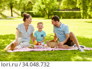 Купить «happy family having picnic at summer park», фото № 34048732, снято 30 июня 2019 г. (c) Syda Productions / Фотобанк Лори