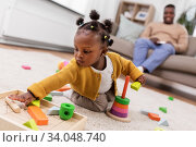 Купить «african baby girl playing with toy blocks at home», фото № 34048740, снято 29 сентября 2019 г. (c) Syda Productions / Фотобанк Лори