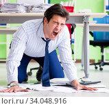Купить «Frustrated businessman stressed from excessive work», фото № 34048916, снято 1 июня 2018 г. (c) Elnur / Фотобанк Лори