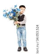 Купить «Funny little boy holding a large bouquet of flowers», фото № 34053524, снято 6 апреля 2015 г. (c) Nataliia Zhekova / Фотобанк Лори