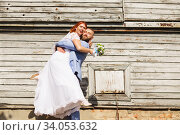 Купить «Just married loving hipster couple in wedding dress and suit in the park. Happy bride and groom walking running and dancing. Romantic Married young family.», фото № 34053632, снято 5 октября 2018 г. (c) Nataliia Zhekova / Фотобанк Лори