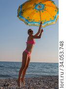 Smiling woman in sunglasses Flying with colorful umbrella in the blue sky. Стоковое фото, фотограф Константин Сиятский / Фотобанк Лори