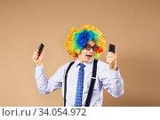 Купить «Businessman respond to numerous phone calls. Businessman holding two mobile phones», фото № 34054972, снято 28 февраля 2016 г. (c) Nataliia Zhekova / Фотобанк Лори