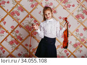 Купить «Beautiful little girl playing on violin against the background of wallpaper», фото № 34055108, снято 12 декабря 2015 г. (c) Nataliia Zhekova / Фотобанк Лори