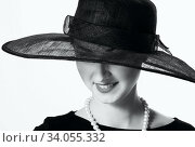 Close-up portrait of a beautiful woman in a black hat in retro style. Стоковое фото, фотограф Nataliia Zhekova / Фотобанк Лори