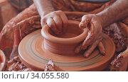 Купить «Close up of hands working on pottery wheel in workshop», видеоролик № 34055580, снято 4 июля 2020 г. (c) Яков Филимонов / Фотобанк Лори