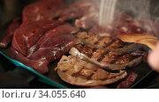 Купить «Close up of frying on grill tasty pork liver, nobody», видеоролик № 34055640, снято 25 апреля 2020 г. (c) Яков Филимонов / Фотобанк Лори