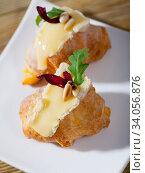 Купить «Camembert on top of croissant with pine nuts», фото № 34056876, снято 16 июля 2020 г. (c) Яков Филимонов / Фотобанк Лори