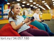 Купить «Children plays game console, entertainment center», фото № 34057180, снято 10 марта 2020 г. (c) Tryapitsyn Sergiy / Фотобанк Лори