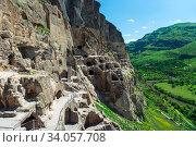 Купить «tourist attraction of Georgia Vardzia - cave city in the rock», фото № 34057708, снято 13 июня 2018 г. (c) Константин Лабунский / Фотобанк Лори