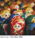 Купить «Colorful Russian nesting dolls matreshka at the market. Matrioshka Nesting dolls Babushka are the most popular souvenirs from Russia.», фото № 34066388, снято 18 августа 2013 г. (c) easy Fotostock / Фотобанк Лори
