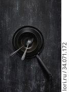 Купить «Kitchen utensils collection black colored on the came color background.», фото № 34071172, снято 2 июня 2020 г. (c) Ярослав Данильченко / Фотобанк Лори