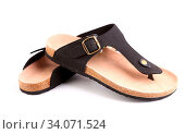 Купить «A pair of sandals without backs are located on a white background», фото № 34071524, снято 3 июля 2020 г. (c) age Fotostock / Фотобанк Лори
