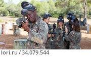 Купить «Male player aiming and shooting with gun», фото № 34079544, снято 11 августа 2018 г. (c) Яков Филимонов / Фотобанк Лори
