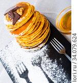 Купить «Pancakes with honey and chocolate», фото № 34079624, снято 12 июля 2020 г. (c) Яков Филимонов / Фотобанк Лори