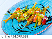 Fried sardines in batter and creamy-ginger sauce, sweet tomatoes and balsamic paste. Стоковое фото, фотограф Яков Филимонов / Фотобанк Лори