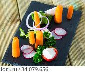 Купить «Raw vegetables with baby carrots», фото № 34079656, снято 11 июля 2020 г. (c) Яков Филимонов / Фотобанк Лори