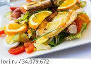 Купить «Salad with goat cheese, greens, vegetables», фото № 34079672, снято 6 октября 2018 г. (c) Яков Филимонов / Фотобанк Лори