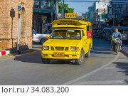Купить «CHIANG MAY, THAILAND - DECEMBER 22, 2018: Yellow sontego on a city street in the old city», фото № 34083200, снято 22 декабря 2018 г. (c) Виктор Карасев / Фотобанк Лори