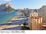 Купить «Sandy beach, Ifach natural park view. Calpe townscape, Costa Blanca, Spain», фото № 34083348, снято 3 июля 2020 г. (c) Alexander Tihonovs / Фотобанк Лори