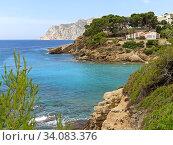 Купить «Picturesque view idyllic scenery Benissa rocky coastline. Turquoise water of Mediterranean Sea sunny day. Travel and tourism beautiful places concept. Province of Alicante, Costa Blanca, Espana. Spain», фото № 34083376, снято 3 июля 2020 г. (c) Alexander Tihonovs / Фотобанк Лори