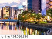 Купить «Fukuoka old town along naka river at Nakasukawabata sunset twilight. This area is favorite for tourist for Fukuoka Yatai, street Food stall, for hangout at night.», фото № 34086896, снято 5 июля 2020 г. (c) easy Fotostock / Фотобанк Лори