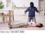 Купить «Gangster and young woman in robbery concept», фото № 34087880, снято 15 мая 2019 г. (c) Elnur / Фотобанк Лори