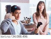Купить «Man doing make-up for cute woman in beauty salon», фото № 34088496, снято 18 декабря 2017 г. (c) Elnur / Фотобанк Лори