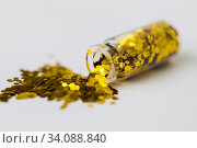 golden glitters poured from small glass bottle. Стоковое фото, фотограф Syda Productions / Фотобанк Лори