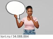Купить «african american woman holding speech bubble», фото № 34088884, снято 26 января 2020 г. (c) Syda Productions / Фотобанк Лори