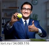 Купить «Young employee with tennis ball», фото № 34089116, снято 9 октября 2017 г. (c) Elnur / Фотобанк Лори