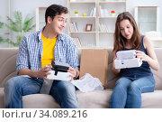Купить «Young family playing games with virtual reality glasses», фото № 34089216, снято 23 мая 2017 г. (c) Elnur / Фотобанк Лори