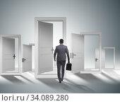Businessman facing many business opportunities. Стоковое фото, фотограф Elnur / Фотобанк Лори