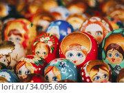 Купить «Colorful Russian Nesting Dolls Matreshka At Market. Matrioshka Babushka Nesting Dolls Are Most Popular Souvenirs From Russia.», фото № 34095696, снято 18 августа 2013 г. (c) easy Fotostock / Фотобанк Лори
