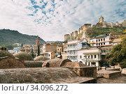 Tbilisi, Georgia. Abanotubani - Bath District - Is Ancient District Of Tbilisi. Also Known As Sulfuric Baths. Narikala Fortress. Стоковое фото, фотограф Ryhor Bruyeu / easy Fotostock / Фотобанк Лори