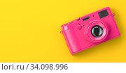 Купить «Pink vintage photo camera on yellow background.», фото № 34098996, снято 7 июля 2020 г. (c) Maksym Yemelyanov / Фотобанк Лори