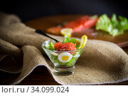 Купить «lettuce salad with salted salmon, boiled eggs», фото № 34099024, снято 31 марта 2020 г. (c) Peredniankina / Фотобанк Лори
