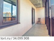 Small balcony interior in modern apartment building. Стоковое фото, фотограф Ольга Сапегина / Фотобанк Лори