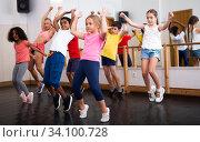 Купить «Boys and girls training in dance studio», фото № 34100728, снято 15 июля 2020 г. (c) Яков Филимонов / Фотобанк Лори