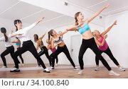 Купить «Fitness women practicing zumba movements», фото № 34100840, снято 21 сентября 2019 г. (c) Яков Филимонов / Фотобанк Лори