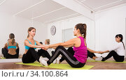 Group yoga classes in a fitness club. Стоковое фото, фотограф Яков Филимонов / Фотобанк Лори