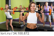 Portrait of athletic young women exercising with barbell. Стоковое фото, фотограф Яков Филимонов / Фотобанк Лори
