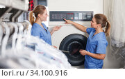 Two adult workers of laundry during daily work. Стоковое фото, фотограф Яков Филимонов / Фотобанк Лори