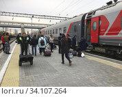Купить «The train to Moscow is about to depart from Vladivostok, Far East, Russia, Russian. The Trans-Siberian Railway. Photo: André Maslennikov.», фото № 34107264, снято 19 октября 2018 г. (c) age Fotostock / Фотобанк Лори