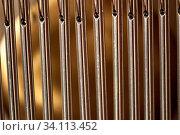 Купить «Bar chimes with steel tubes for relaxation and meditation.», фото № 34113452, снято 5 июля 2020 г. (c) age Fotostock / Фотобанк Лори
