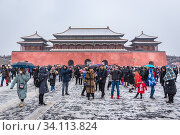 Купить «Tourists after pass Wumen - Meridian Gate, southern and largest gate to Forbidden City palace complex in central Beijing, China.», фото № 34113824, снято 12 февраля 2019 г. (c) age Fotostock / Фотобанк Лори